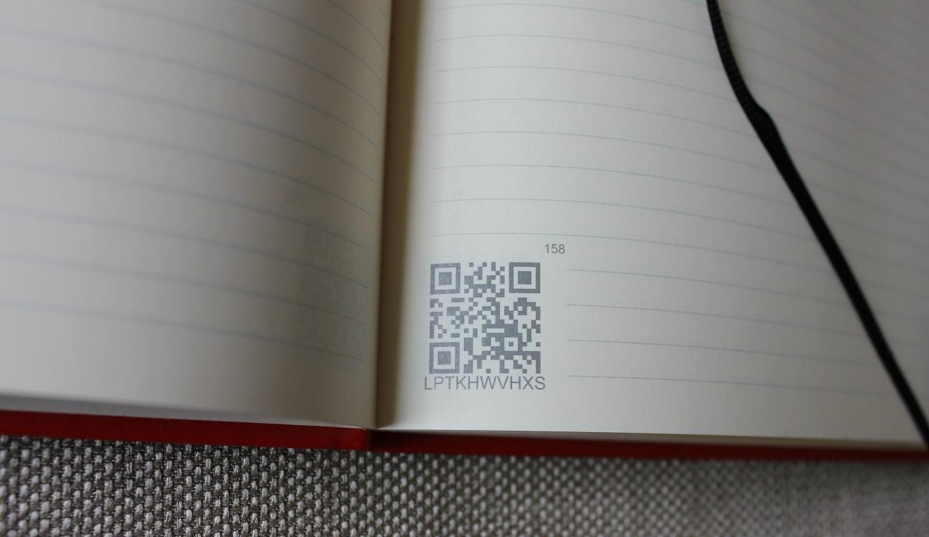 QR Code in open book